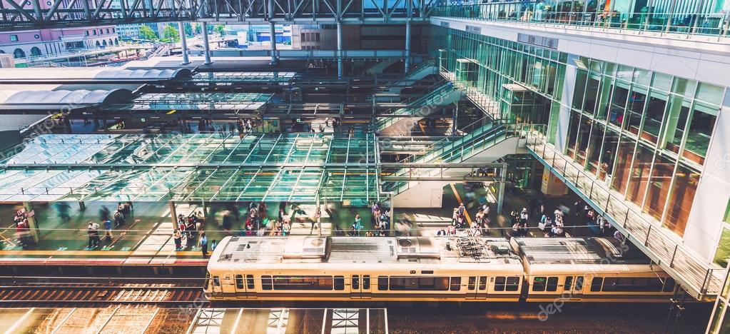 Commuters boarding trains inside the massive Osaka Station