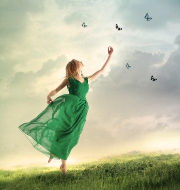 Woman chasing butterflies