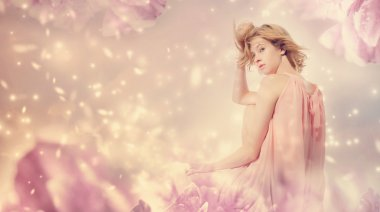 Woman in a pink peony fantasy