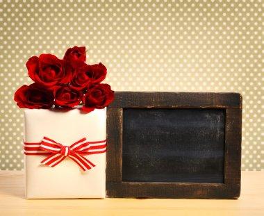 Gift box with blank chalkboard