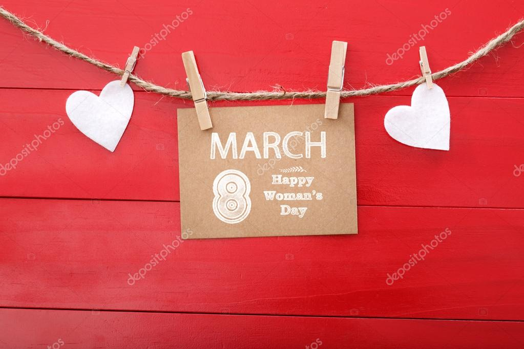 Womans day message with felt hearts hanging with clothespins