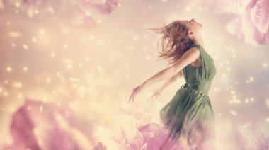 Woman in pink flower fantasy