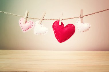 Small Hearts with Stitches Hanging on a String