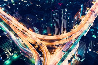 Aerial-view highway junction at night in Tokyo