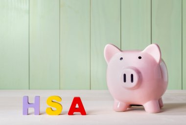 HSA theme withblock letters and a piggy bank