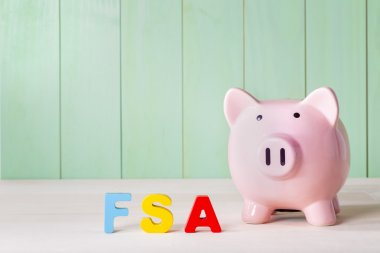 FSA theme with block letters and a piggy bank
