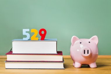 529 college savings plan theme with textbooks