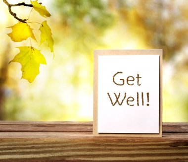 Get well message card over autumn background