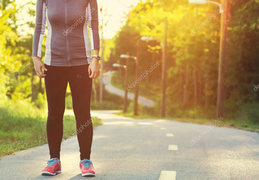 Фотообои Female athlete preparing for a jog on a forest path