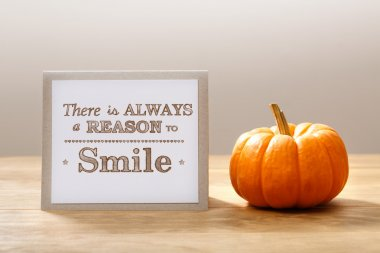 There is a always reasons to smile message with pumpkin