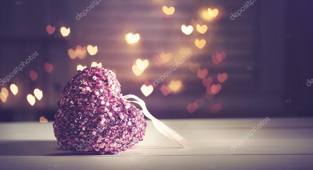 Pink heart on heart shaped background