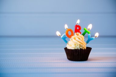 cupcake with a candles for 40 - fortieth birthday