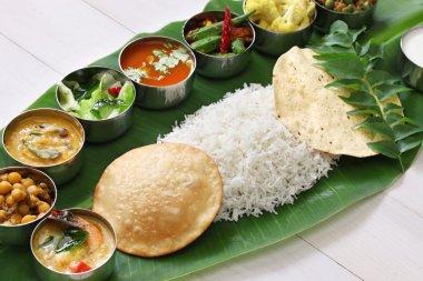 south indian meals served on banana leaf