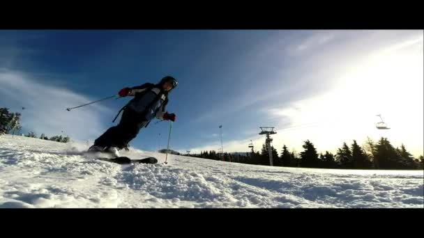 Skier going down on the slope - slow motion view