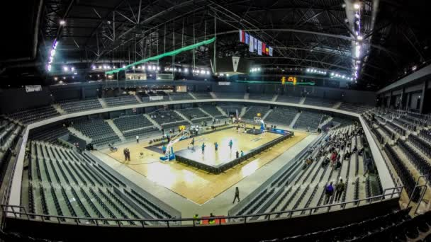 Time lapse of Cluj indoor arena seats filling up with crowd of basketball fans