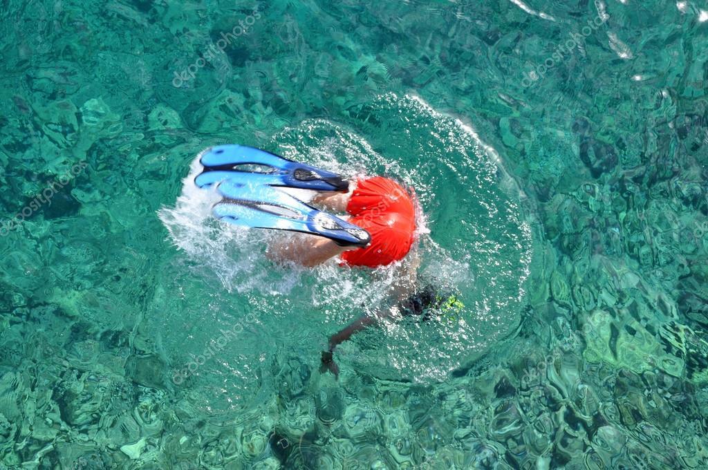 Snorkeler diving in the sea