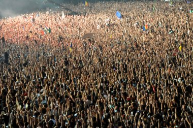 Partying crowd of people during a David Guetta concert