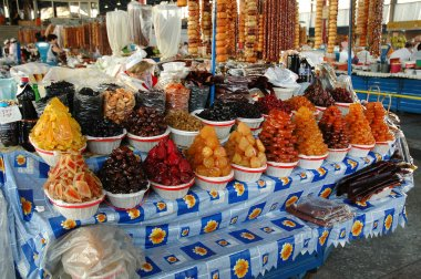Dried fruits, sweets, pickled vegetables and spices in the bazaar