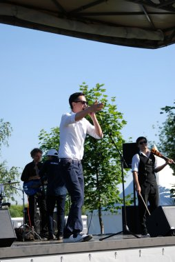 Singer on stage at Sabantui celebration in Moscow