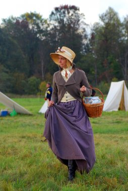 Portrait of a woman-reenactor in vintage clothes.