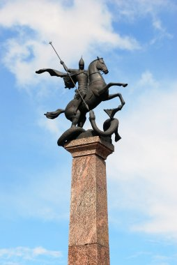 Sculpture of St. George on horseback, striking snake