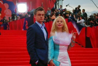 Actress Elena Kondulainen with her son at Moscow Film Festival