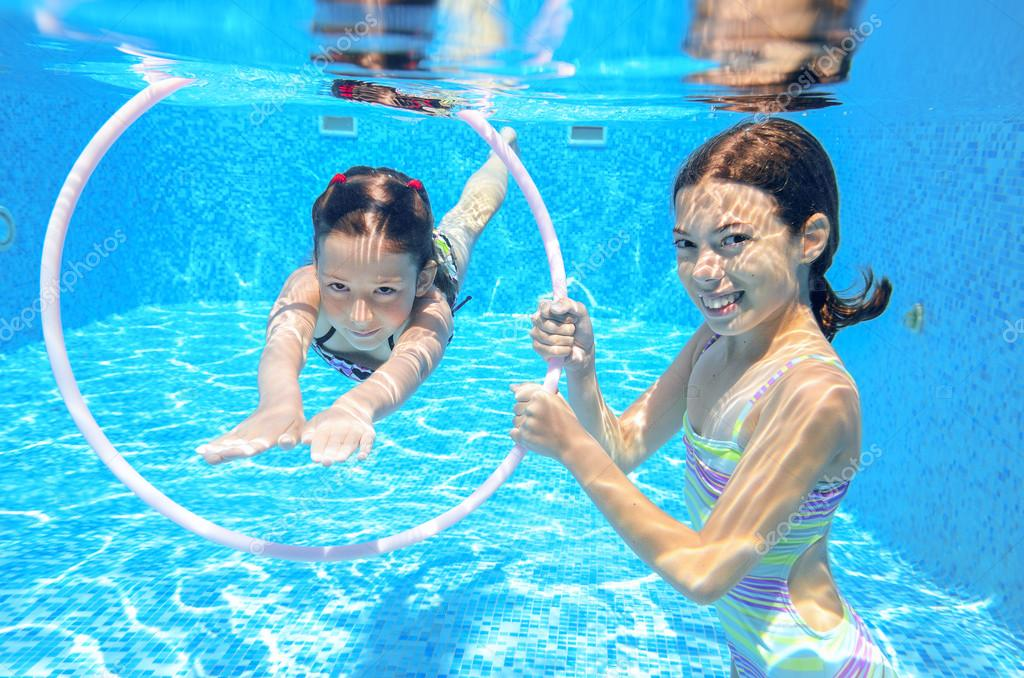 Kids Swimming Underwater kids swim in pool underwater, girls swimming — stock photo © jaysi