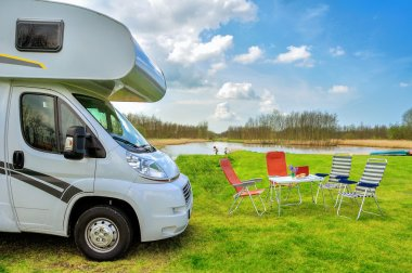 RV (camper) in camping, family vacation travel, trip in motorhome