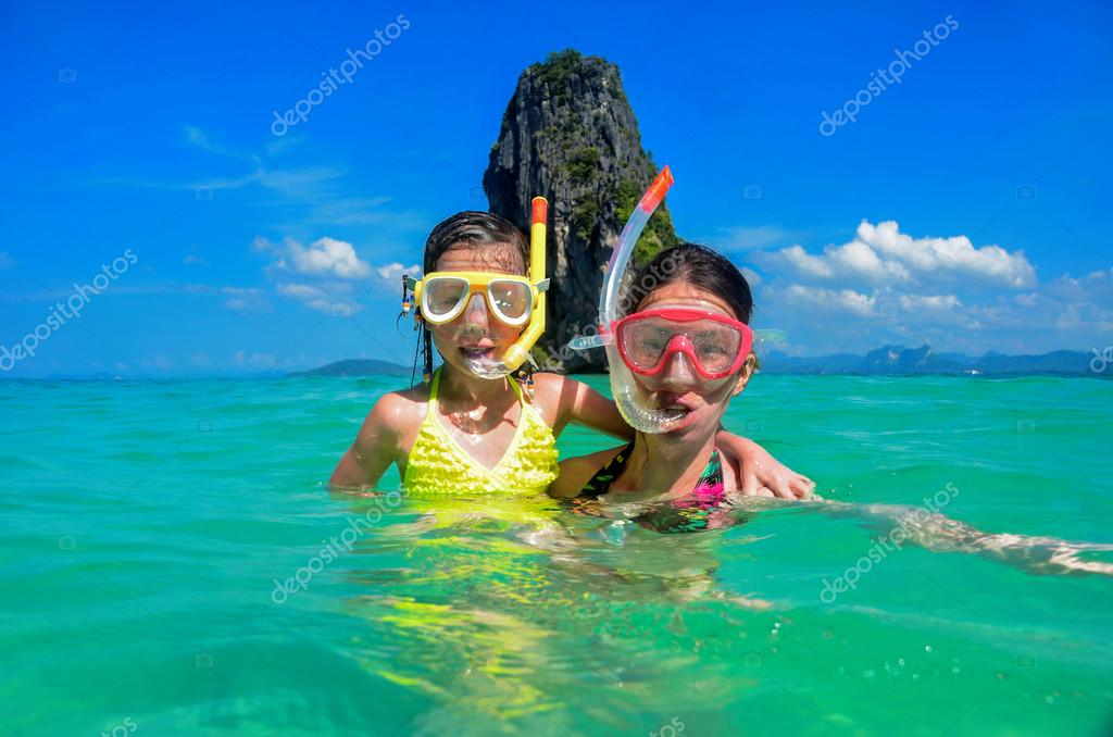 Family vacation, mother and kid snorkeling in sea
