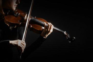 Violin player violinist hands closeup