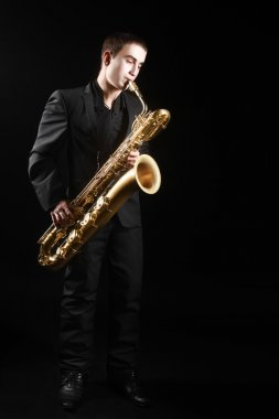 Saxophone player Saxophonist with sax baritone