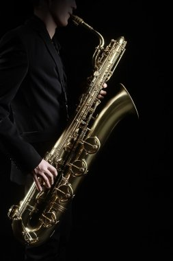 Saxophone player Saxophonist with sax baritone