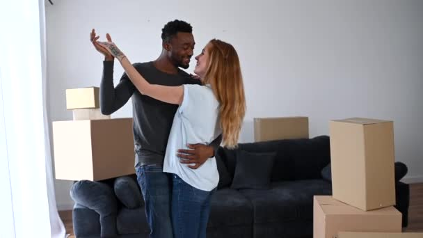 Happy multiracial couple moved in a new house
