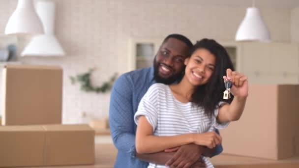 Happy multiracial couple moving in the new house