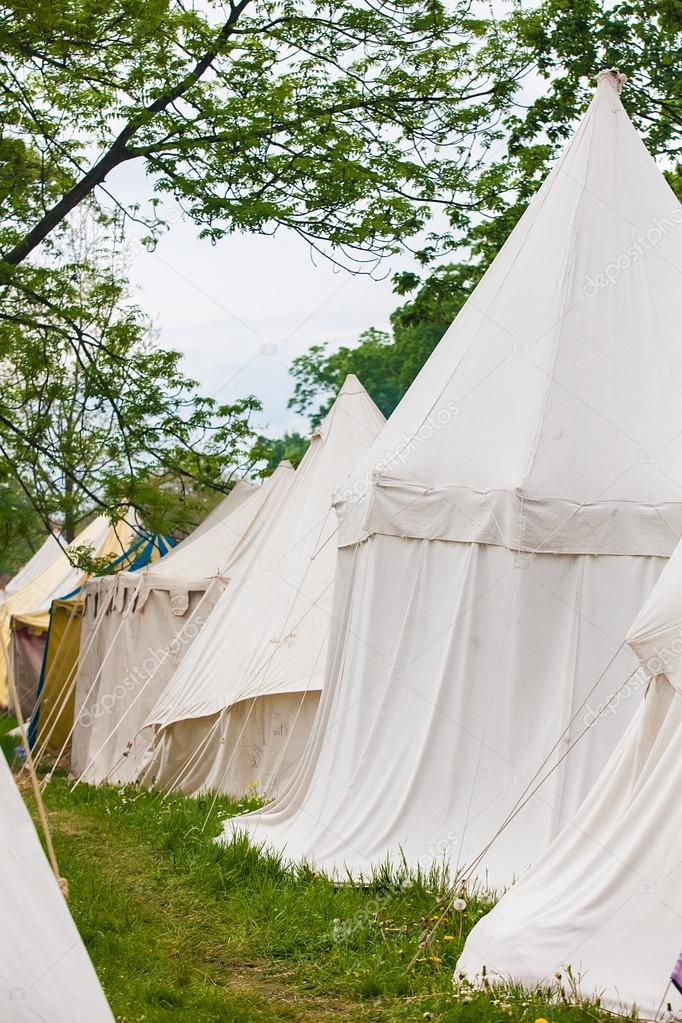 Knights camp with white tents