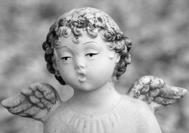 Figurine of singing little angel