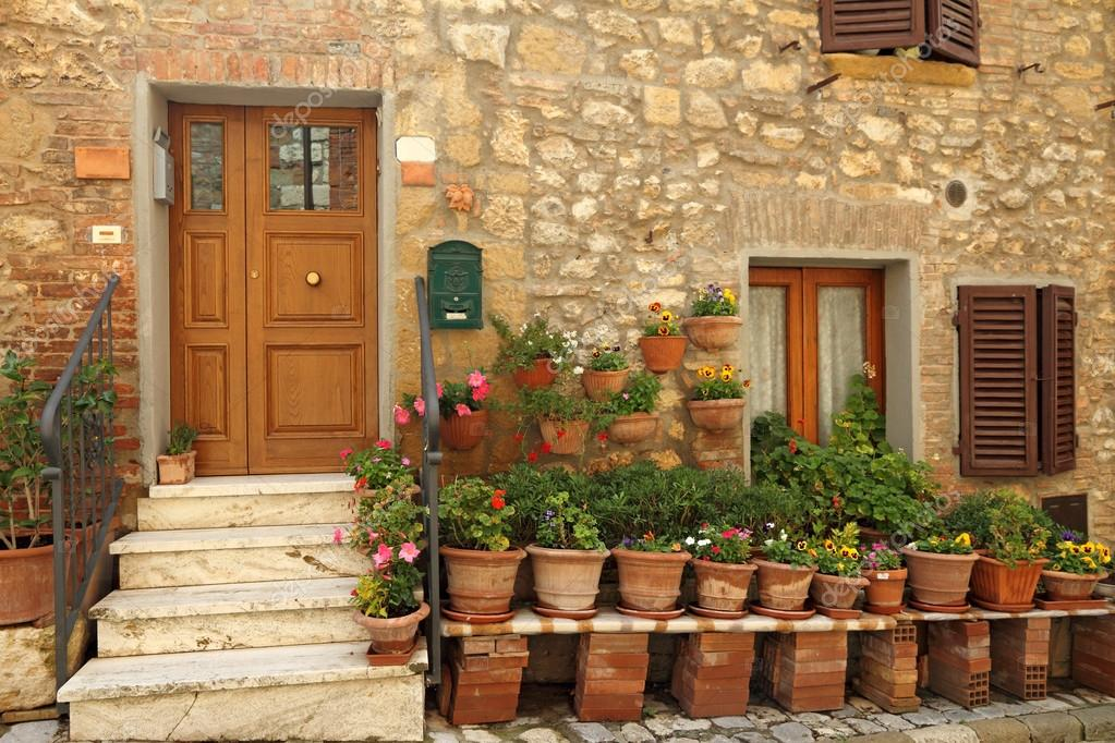 Doorway to the tuscan house with lots of flowerpots Italy u2014 Photo by Malgorzata_Kistryn & Doorway to tuscan house u2014 Stock Photo © Malgorzata_Kistryn #80720078