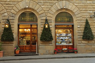 FLORENCE - DEC 5:Rivoire Cafe - founded by royal chocolatier  in 1872 -on December,5,2013.Inferno s main character said:no trip to the piazza was complete without sipping an espresso at Caffe Rivoire. stock vector