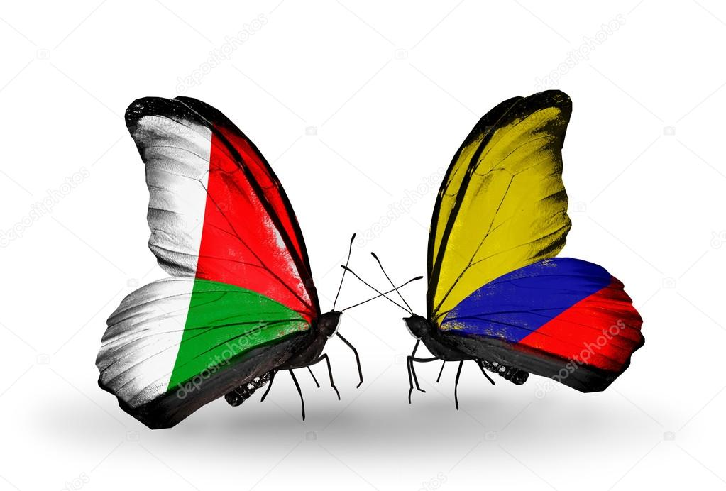 Butterflies With Madagascar And Columbia Flags Stock Photo