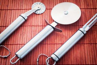 Three stainless steel kitchen tools