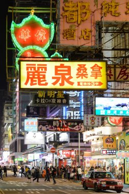 HONG KONG , CHINA - AUG. 17 : Mongkok at night on Aug 17, 2013 in Hong Kong, China. Mongkok in Kowloon is one of the most neon-lighted place in the world and is full of ads of different companies.
