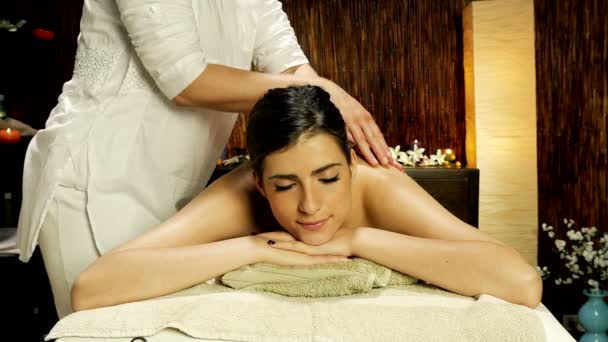 Woman getting too strong massage in spa feeling pain funny wide shot