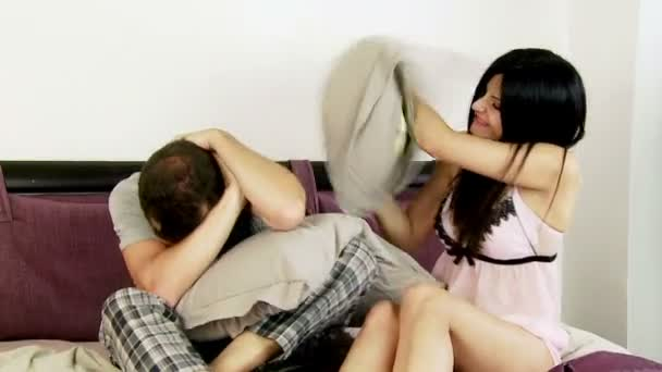 Couple playing pillow fight