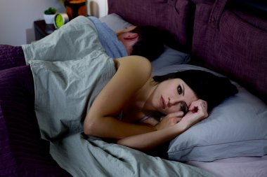 Woman in bed not feeling love anymore couple problems