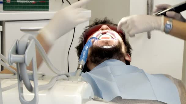 Man getting teeth operation