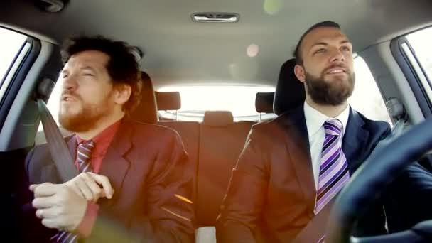 Two Happy Cool Business Men Listening Music Dancing In Car