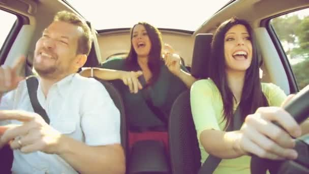 Friends in a car riding and dancing