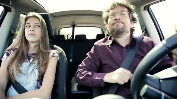Car with dancing man and unhappy woman