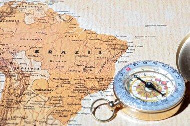 Travel destination Brazil, ancient map with vintage compass