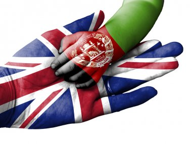 Adult man holding a baby hand with United Kingdom and Afghanistan flags overlaid. Isolated on white